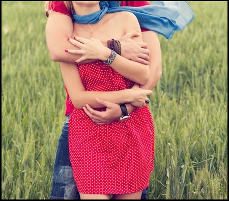 couple-hugging-in-a-meadow 450x395 border